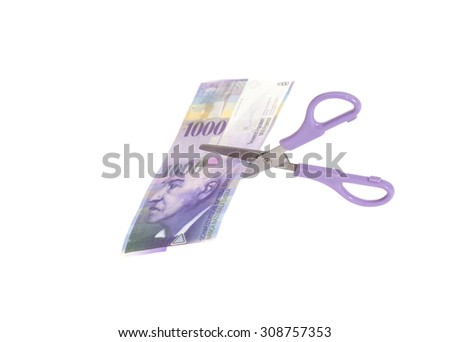 One thousand swiss franc banknotes with scissors.currency of switzerland isolated - stock photo