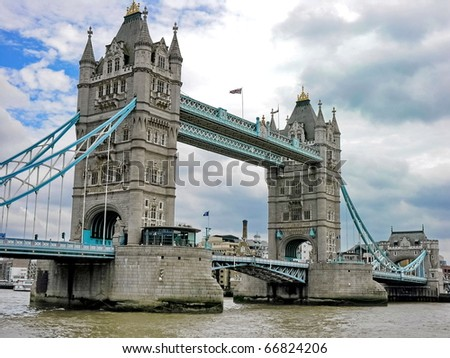 One tower of London Bridge over the River Thames England UK - stock photo