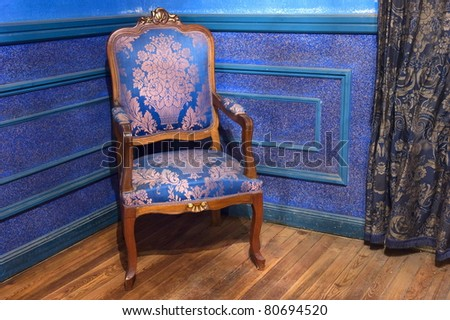 one vintage chair on wooden floor - stock photo