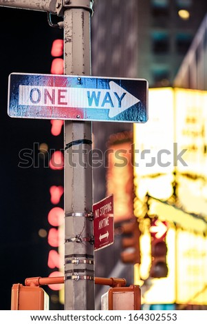 One way New York traffic sign with illuminated and blurred background - stock photo