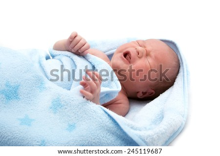 One week old crying baby in a blanket on white background - stock photo