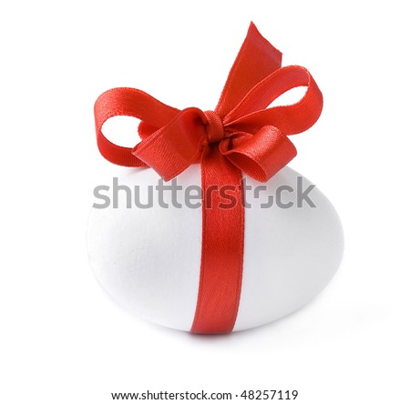 One White egg wrapped around with red ribbon bow isolated over white background - stock photo
