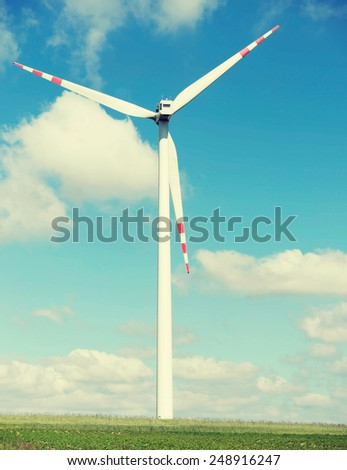 One windmill power generator on summer day. - stock photo