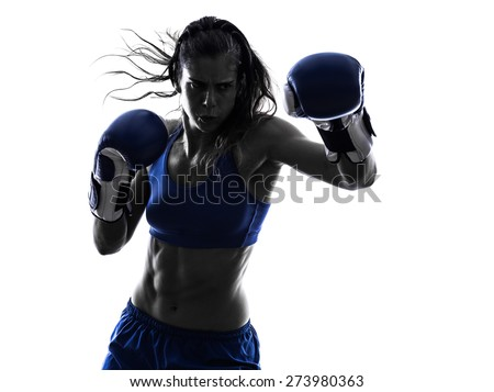 one woman boxer boxing kickboxing in silhouette isolated on white background - stock photo