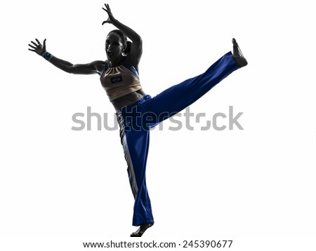 one  woman capoeira dancer dancing in silhouette studio isolated on white background - stock photo