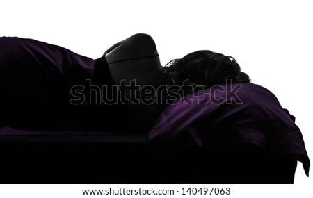 one woman in bed sleeping lying on back silhouette studio on white background - stock photo