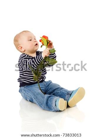 One year boy sitting on floor isolated on white - stock photo