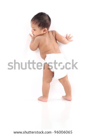 One year old asian baby walking isolated with large copy-space - stock photo