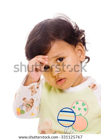 One year old baby boy worried on white background Mumbai, Maharashtra, India, Southeast Asia. - stock photo