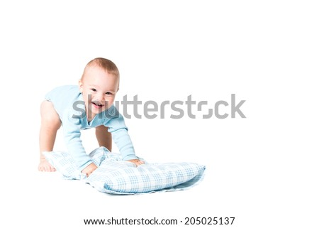 one year old boy playing with pillow, isolated over white background - stock photo