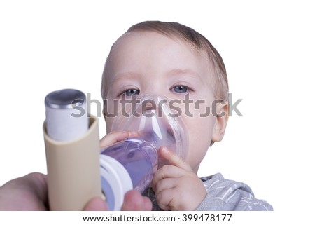 One year old boy using an asthma inhalator - stock photo