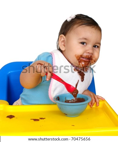 One year old Hispanic baby girl with messy chocolate face, isolated on pure white background - stock photo