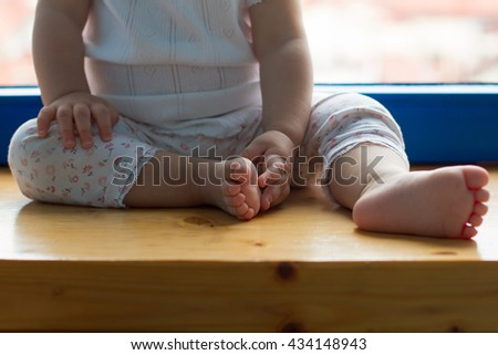One year old old baby hands and feet closeup - stock photo