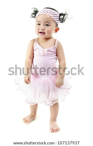 One year old pan Asian baby girl learn walking on her own - stock photo