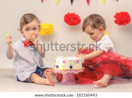 One-year-old twins on the birthday - stock photo