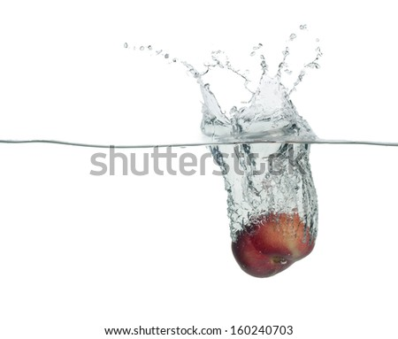 one yellow peach drop in water with splashes - stock photo