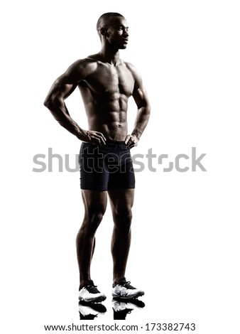 one young african muscular build man standing topless silhouette  isolated on white background - stock photo