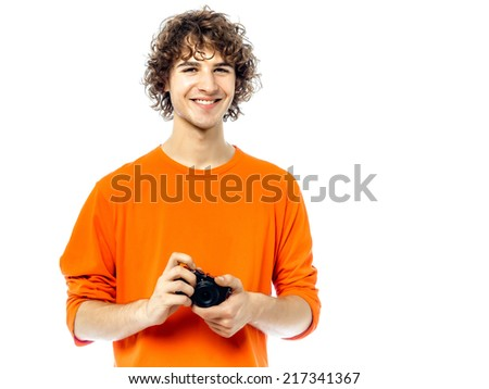 one young man  holding camera portrait in studio white background - stock photo