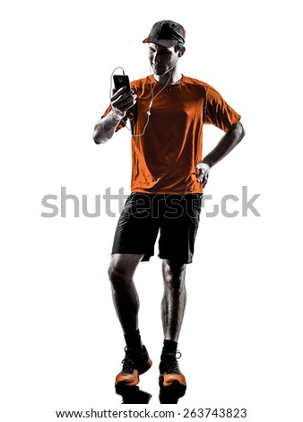 one young man runner jogger using smartphones headphones in silhouette isolated on white background - stock photo