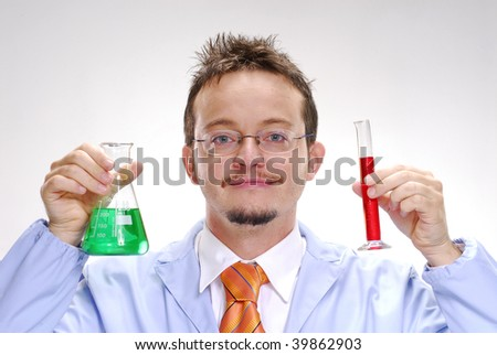 One young scientist holding an experimental tubes. A doctor holding a glass tubes. - stock photo
