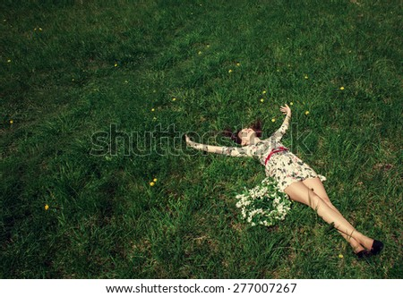 One young woman Feeling free outdoor in the wheat  - stock photo