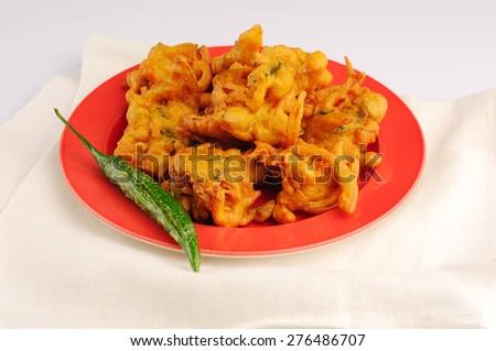 onion bhajis or pakora, fried Indian snack - stock photo