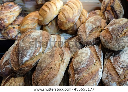 Onion bread and group of baked goods from a bakery - stock photo