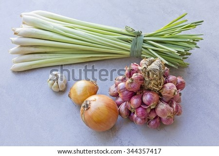 onion & Shallot  & garlic and lemongrass on tile surface background - copy space - stock photo