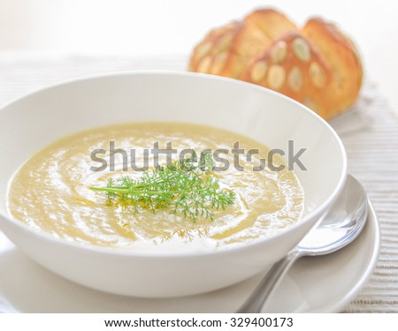 Onion soup with homemade bread  - stock photo