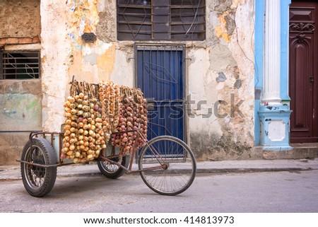 Onions seller in a street of Old Havana, Cuba - stock photo