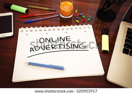 Online Advertising - handwritten text in a notebook on a desk - 3d render illustration. - stock photo