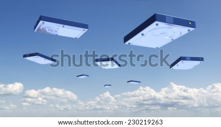 Online Backup Hard Disk Clouds - stock photo