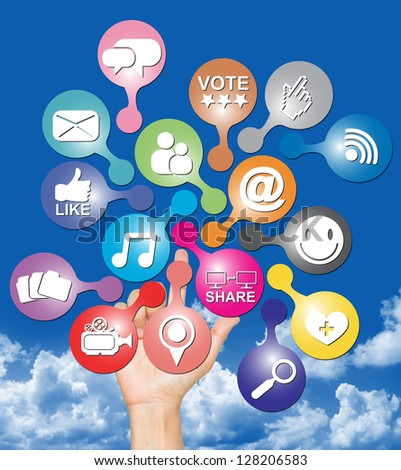 Online Communication Or Social Network Concept Present By Hand With Group of Colorful Social Network Icon in Blue Sky Background - stock photo