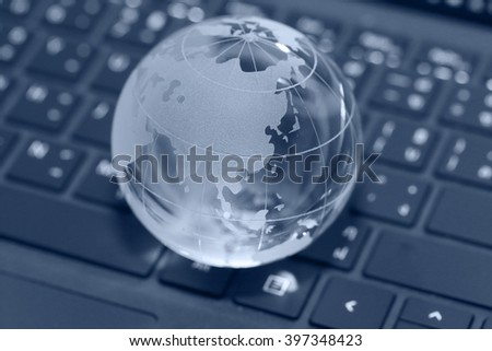 online concept of background of globe on the laptop keyboard - stock photo