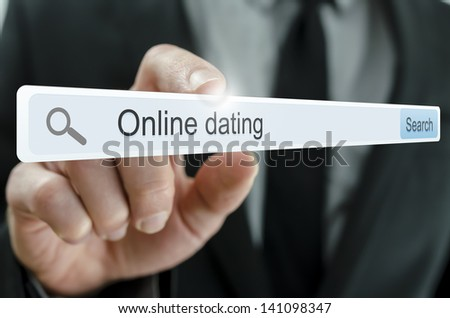 Online dating written in search bar on virtual screen. - stock photo