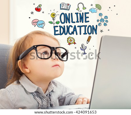 Online Education concept with toddler girl using her laptop - stock photo