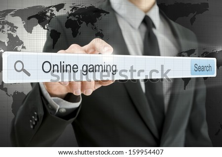 Online gaming written in search bar on virtual screen. Elements of this image furnished by NASA. - stock photo