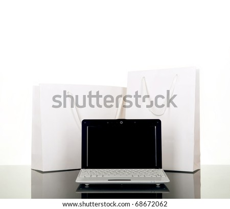 Online Internet Shopping, style laptop and white gift bag - stock photo