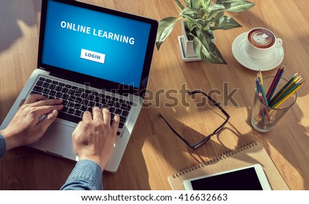 ONLINE LEARNING man hand on table Business, coffee, Split tone - stock photo