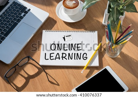 ONLINE LEARNING open book on table and coffee Business - stock photo