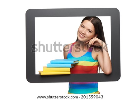 Online library / learning concept. Happy young woman showing stack of books through tablet frame, over white background - stock photo