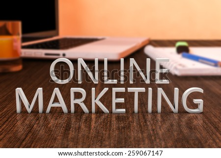 Online Marketing - letters on wooden desk with laptop computer and a notebook. 3d render illustration. - stock photo