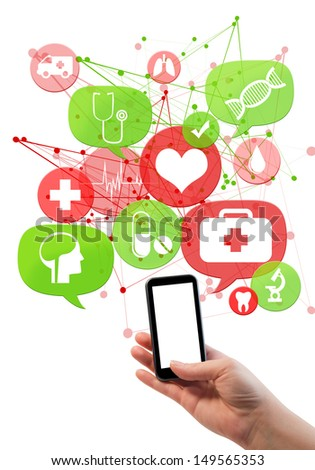 Online medical or pharmacy business template./ Hand holding mobile/cell phone, green and red transparent beveled bubbles/buttons floating of it with medical icons  - stock photo
