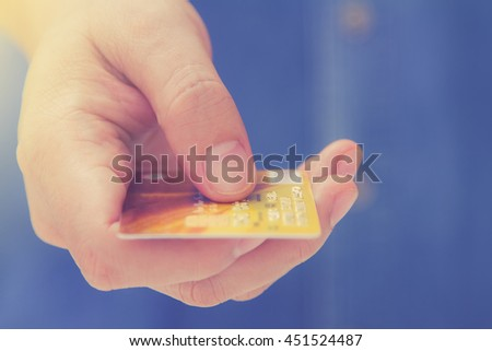 Online payment, hands holding a credit card and using for online shopping,shoping card,shoping content. - stock photo