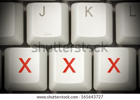 Online porn concept. xxx buttons on the computer keyboard - stock photo