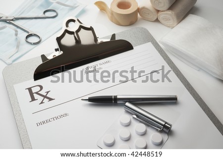 Online rx prescription concept pills pen stethoscope and bandages - stock photo