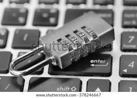 online security concept a lock on computer keyboard - stock photo