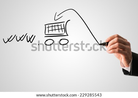 Online shopping and e-commerce concept with a businessman drawing a shopping cart in a www web address on a virtual interface with copyspace. - stock photo