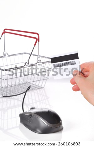 Online shopping basket concept and credit card - stock photo