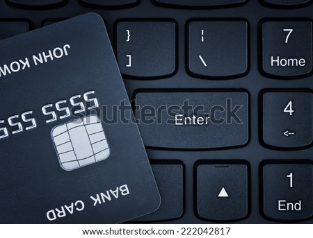 Online shopping. Credit card on a keyboard. - stock photo